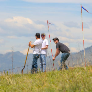 students surveying in field